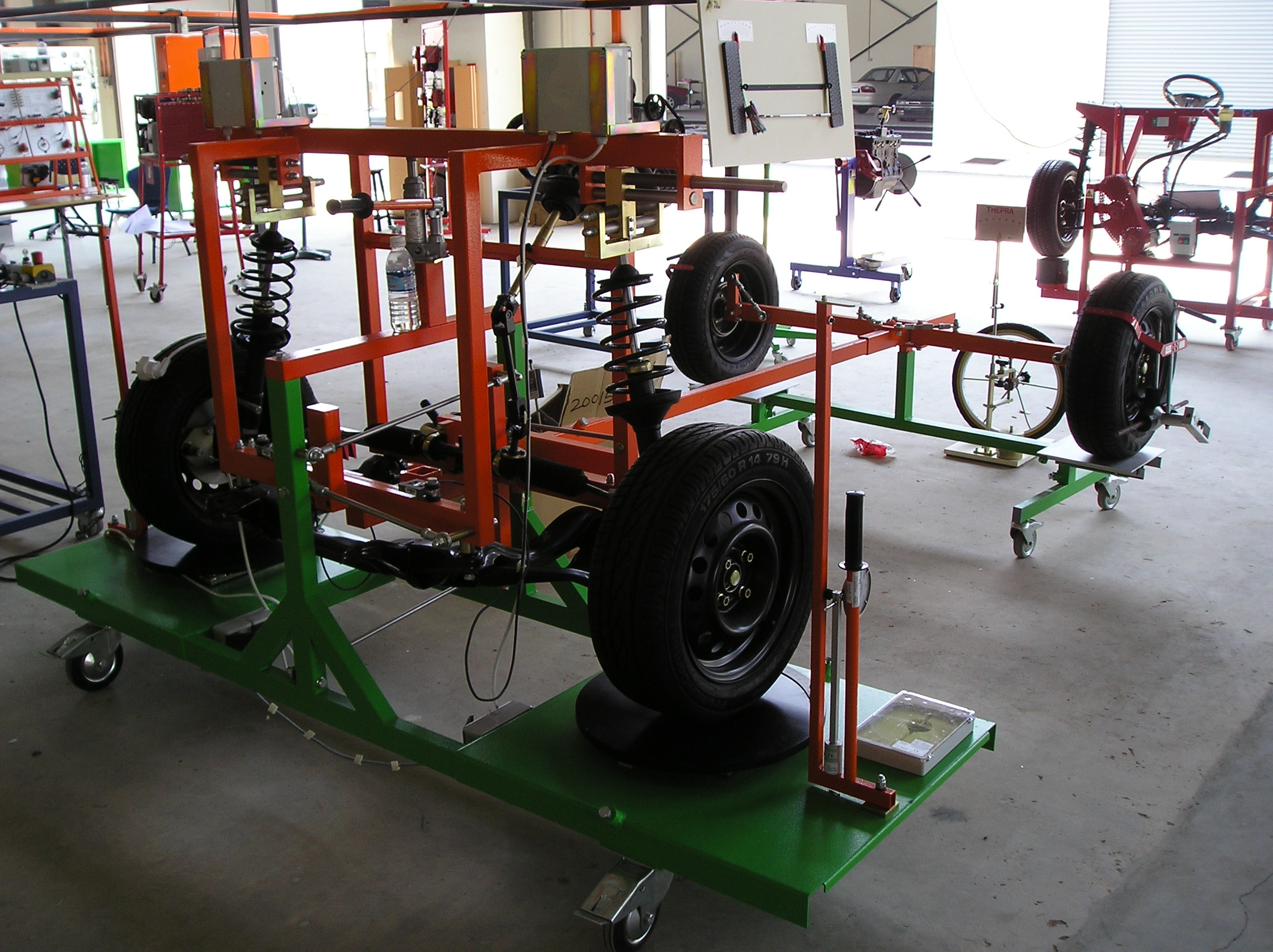 Wheel alignment and steering systems